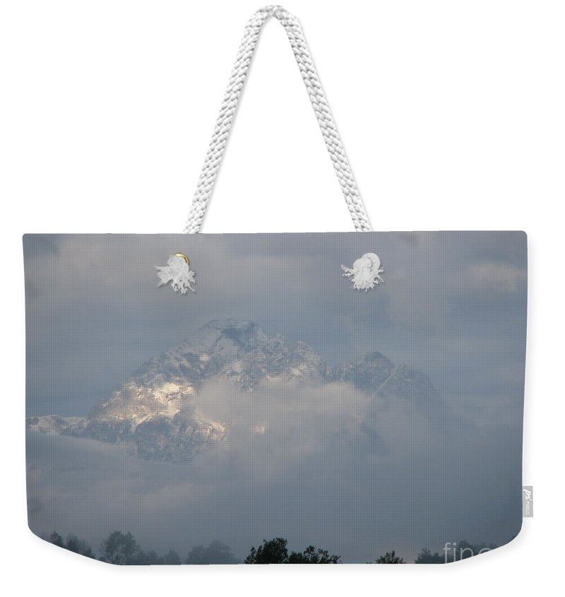 Rocky Mountains Weekender Tote Bag featuring the photograph Out Of The Clouds by Greg Patzer