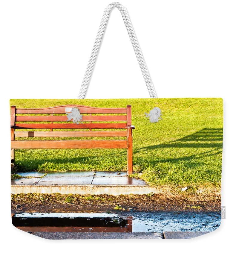 Afternoon Weekender Tote Bag featuring the photograph Park Bench by Tom Gowanlock