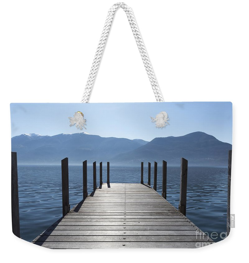 Pier Weekender Tote Bag featuring the photograph Pier On An Alpine Lake by Mats Silvan