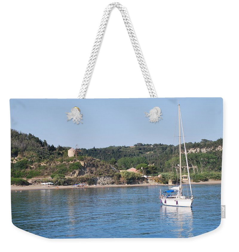 Seascape Weekender Tote Bag featuring the photograph Porto Bay by George Katechis
