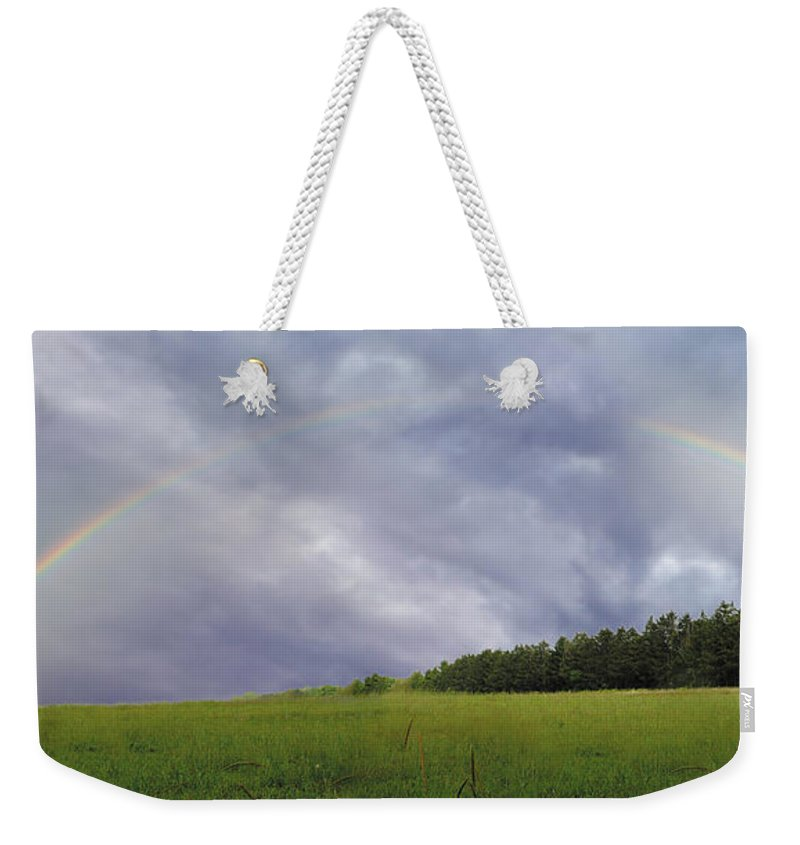 Rainbow Dark Sky Weekender Tote Bag featuring the photograph Rainbow After A Storm by Joseph LaPlaca