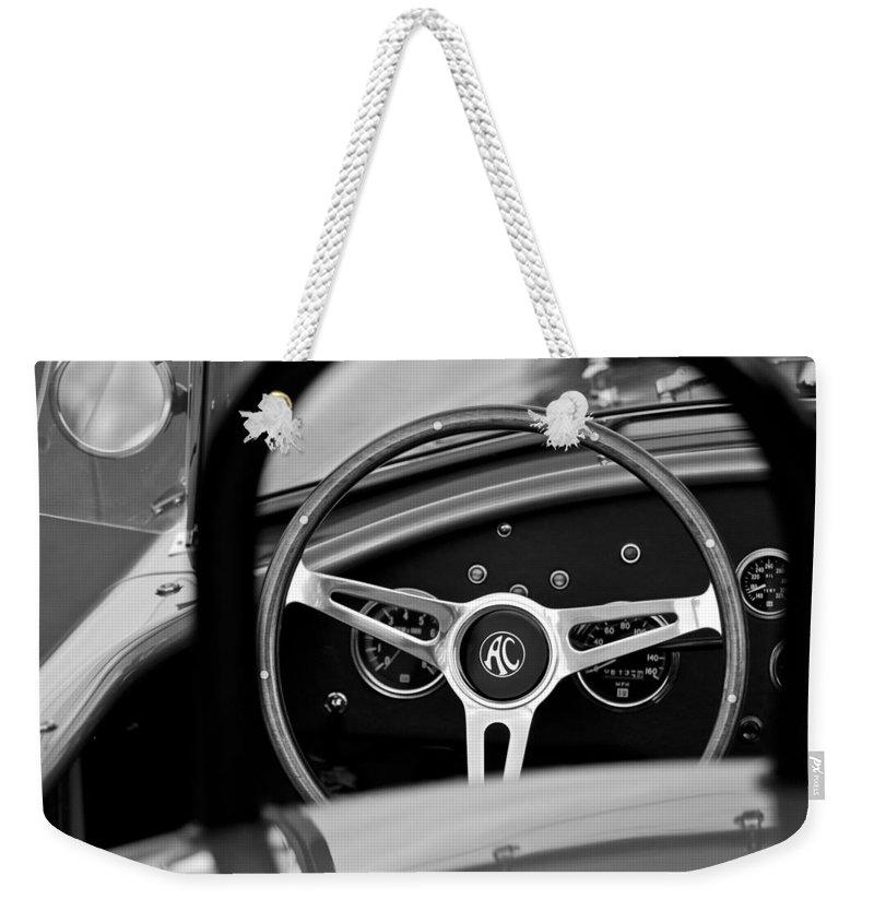 Shelby Ac Cobra Steering Wheel Weekender Tote Bag featuring the photograph Shelby Ac Cobra Steering Wheel by Jill Reger