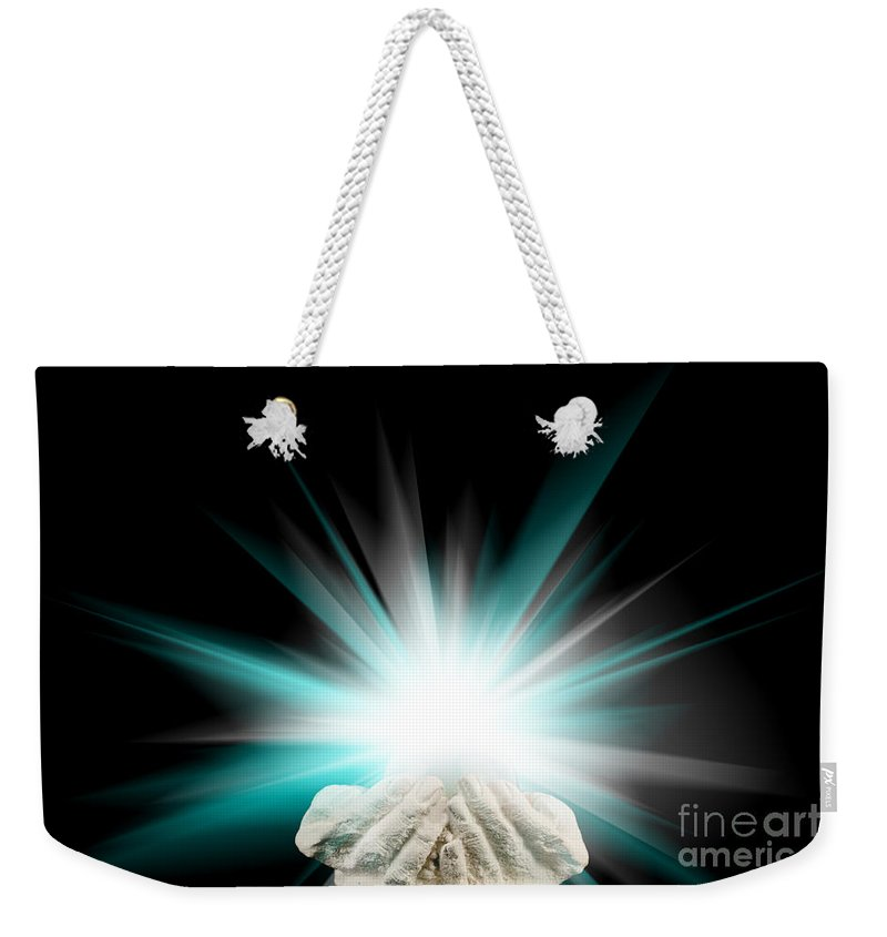 Spiritual Weekender Tote Bag featuring the photograph Spiritual Light In Cupped Hands On A Black Background by Simon Bratt Photography LRPS