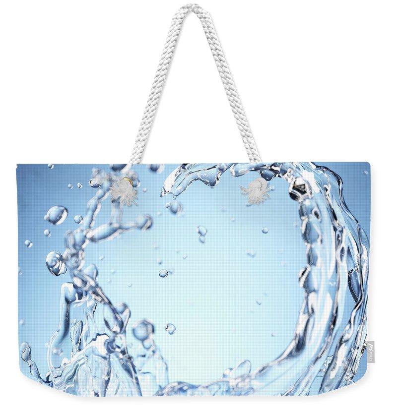 Motion Weekender Tote Bag featuring the digital art Splash Of Water by Maciej Frolow