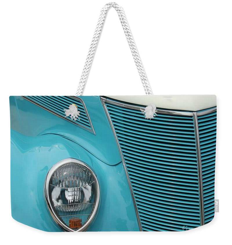 Street Cars Weekender Tote Bag featuring the photograph Street Car Blue Grill With Headlight by Catherine Balfe