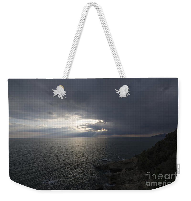 Sea Weekender Tote Bag featuring the photograph Sunlight Over The Sea by Mats Silvan