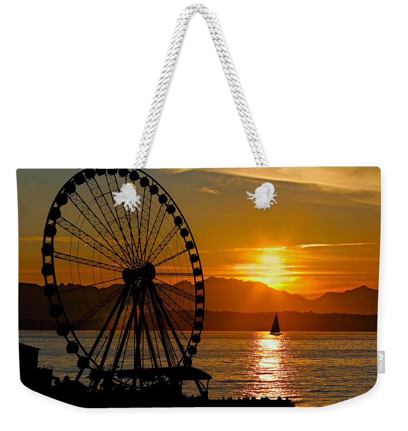Action Weekender Tote Bag featuring the photograph Sunset Ferris Wheel by Paul Fell