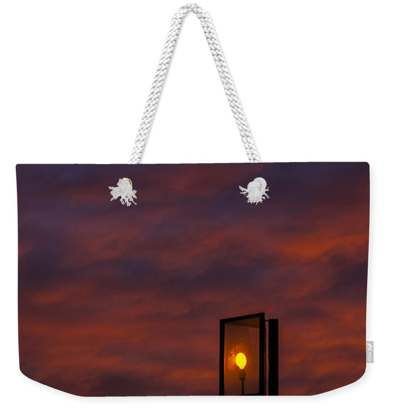 Sun Weekender Tote Bag featuring the photograph Sunset by Paulo Goncalves