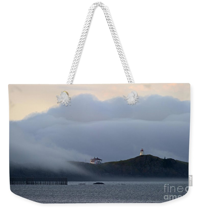Festblues Weekender Tote Bag featuring the photograph Swallowtail Lighthouse... by Nina Stavlund