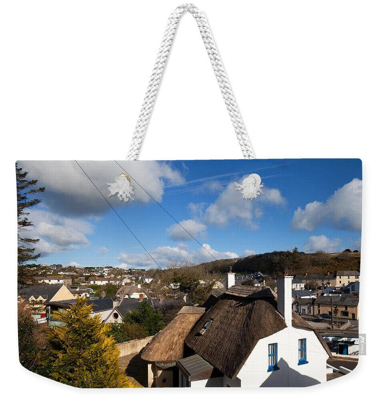 Photography Weekender Tote Bag featuring the photograph Thatched Cottages Near Dunmore Strand by Panoramic Images