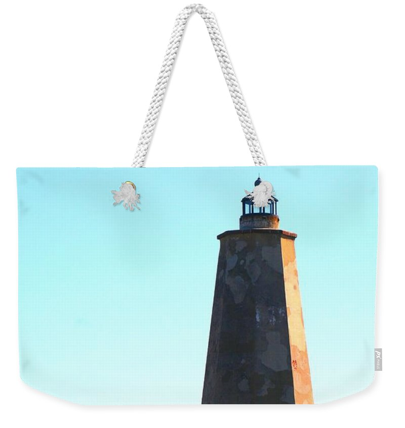 Lighthouse Weekender Tote Bag featuring the photograph The Lighthouse by Nadine Rippelmeyer