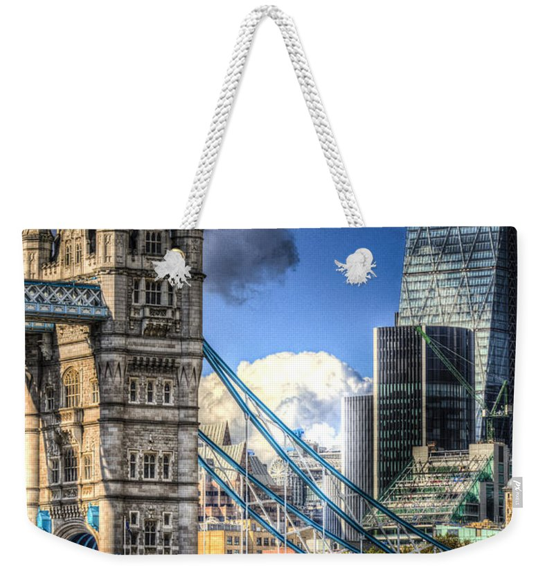 Tower Bridge Weekender Tote Bag featuring the photograph Tower Bridge And The City by David Pyatt