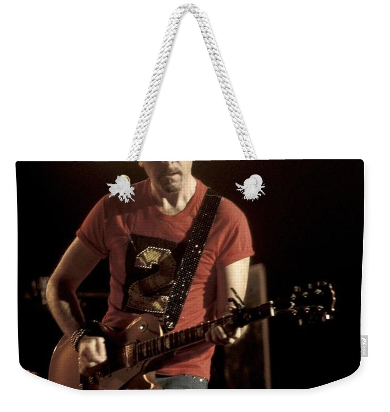Guitarist Weekender Tote Bag featuring the photograph U2 - The Edge by Concert Photos