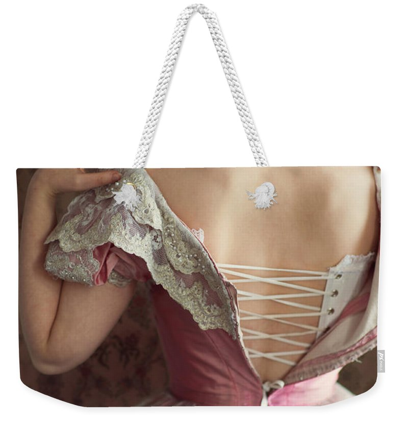 Victorian Weekender Tote Bag featuring the photograph Victorian Woman Undressing by Lee Avison