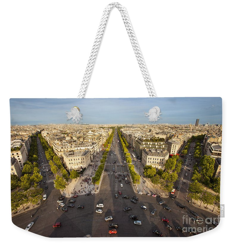 Arc De Triomphe Weekender Tote Bag featuring the photograph View Over Champs Elysees by Brian Jannsen