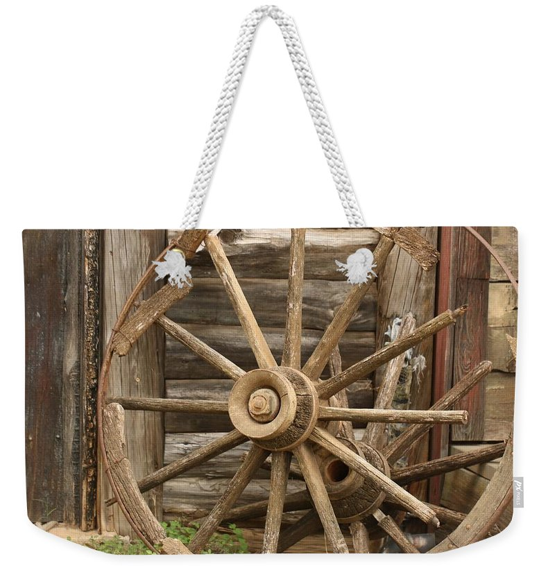 Wagon Wheel Weekender Tote Bag featuring the photograph Wagon Wheel by Terry Fleckney