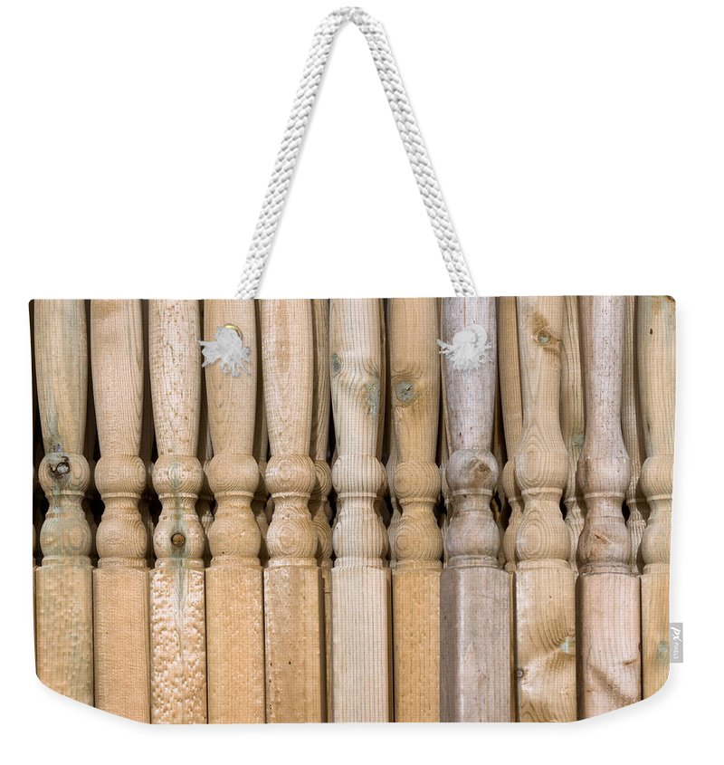 Architecture Weekender Tote Bag featuring the photograph Wooden Posts by Tom Gowanlock