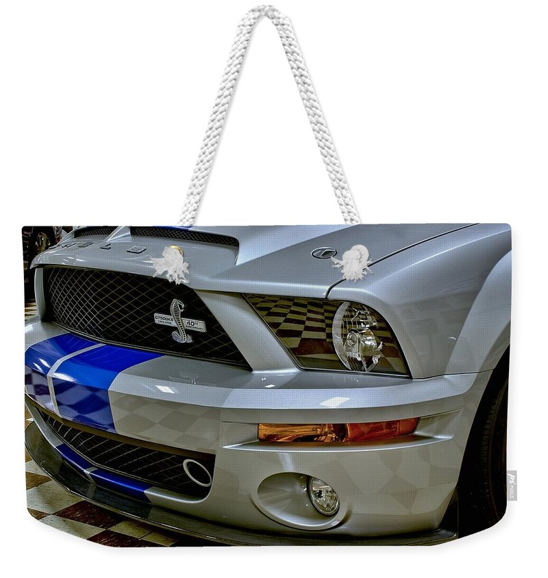 2008 Weekender Tote Bag featuring the photograph 2008 Ford Mustang Shelby Grill Headlight by Michael Gordon