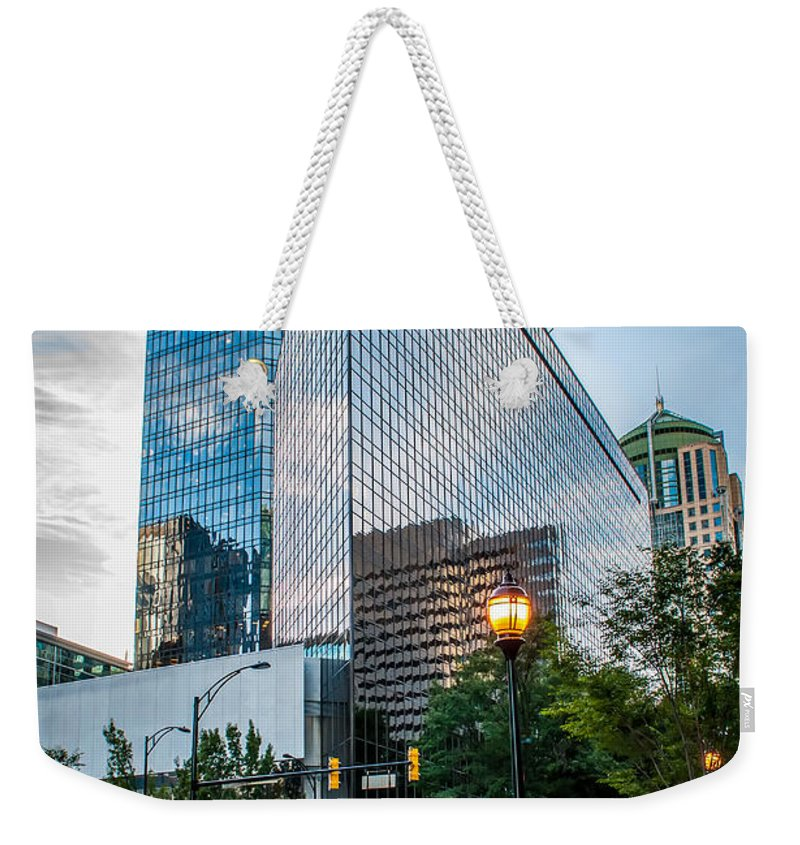 District Weekender Tote Bag featuring the photograph Skyline Of Uptown Charlotte North Carolina by Alex Grichenko