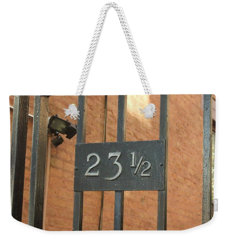 Weekender Tote Bag featuring the photograph 23 And One Half by Katerina Naumenko