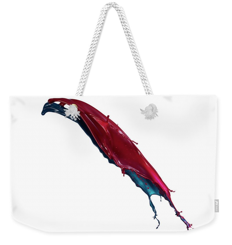 White Background Weekender Tote Bag featuring the photograph Splashing Of The Color Paint by Level1studio