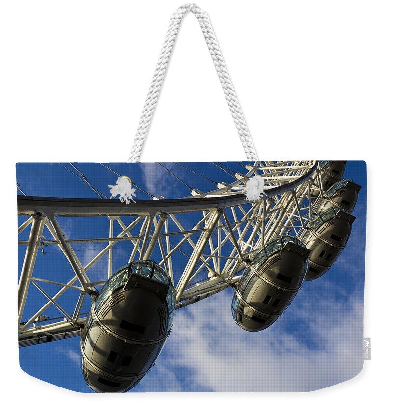 London Eye Weekender Tote Bag featuring the photograph The London Eye by David Pyatt