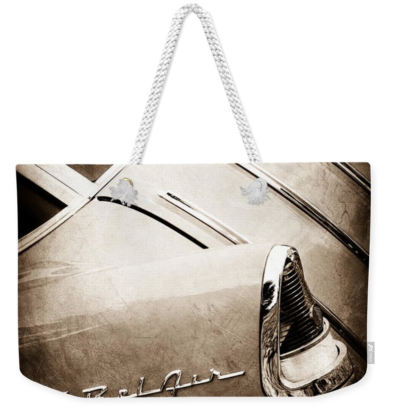 1955 Chevrolet Nomad Wagon Taillight Emblem Weekender Tote Bag featuring the photograph 1955 Chevrolet Nomad Wagon Taillight Emblem by Jill Reger