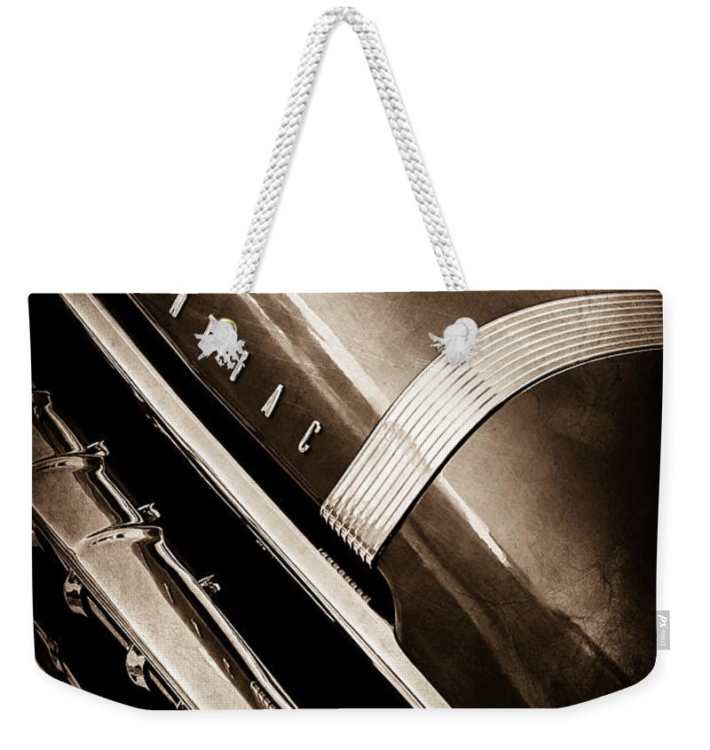 1955 Pontiac Star Chief Grille Emblem Weekender Tote Bag featuring the photograph 1955 Pontiac Star Chief Grille Emblem - Hood Ornament by Jill Reger