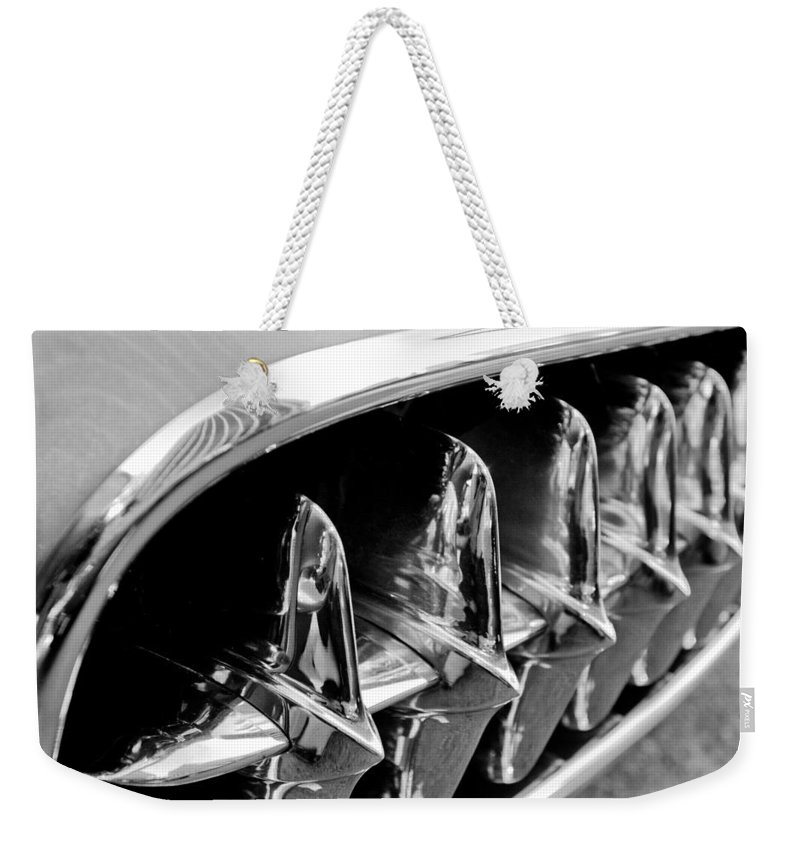 1957 Chevrolet Corvette Grille Weekender Tote Bag featuring the photograph 1957 Chevrolet Corvette Grille by Jill Reger