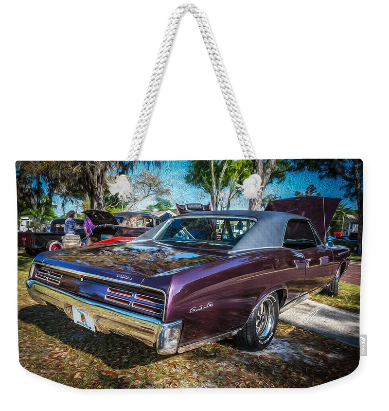 1967 Pontiac Gto Weekender Tote Bag featuring the photograph 1967 Pontiac Gto by Rich Franco
