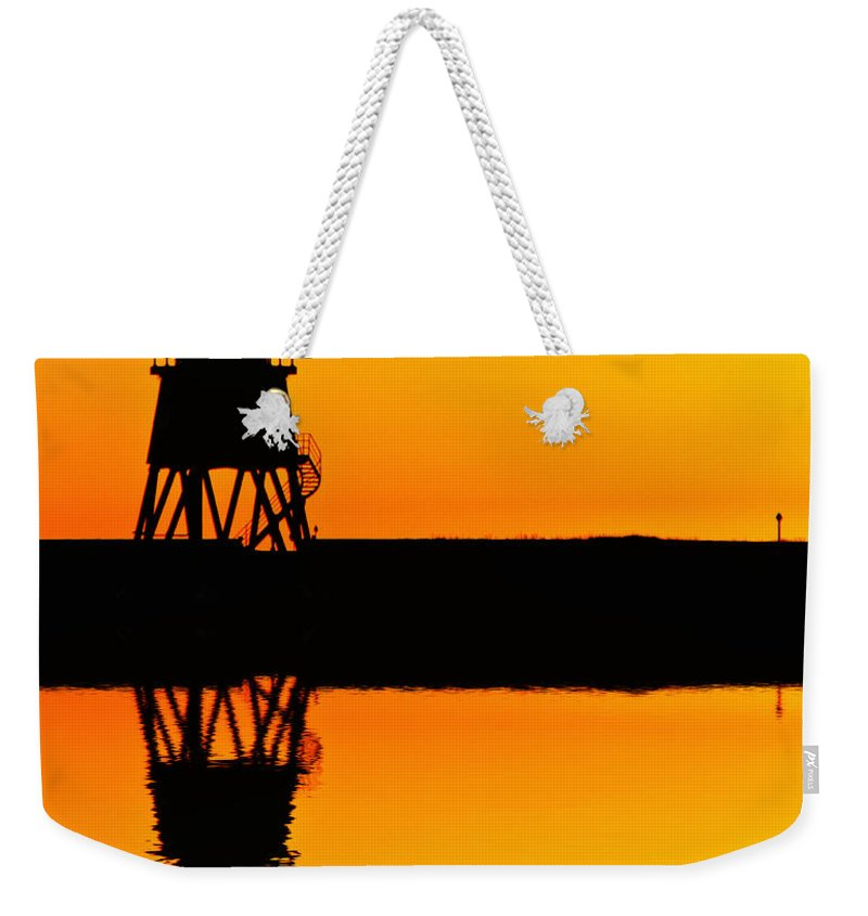 Groyne Weekender Tote Bag featuring the photograph Groyne Lighthouse At Sunrise by David Pringle