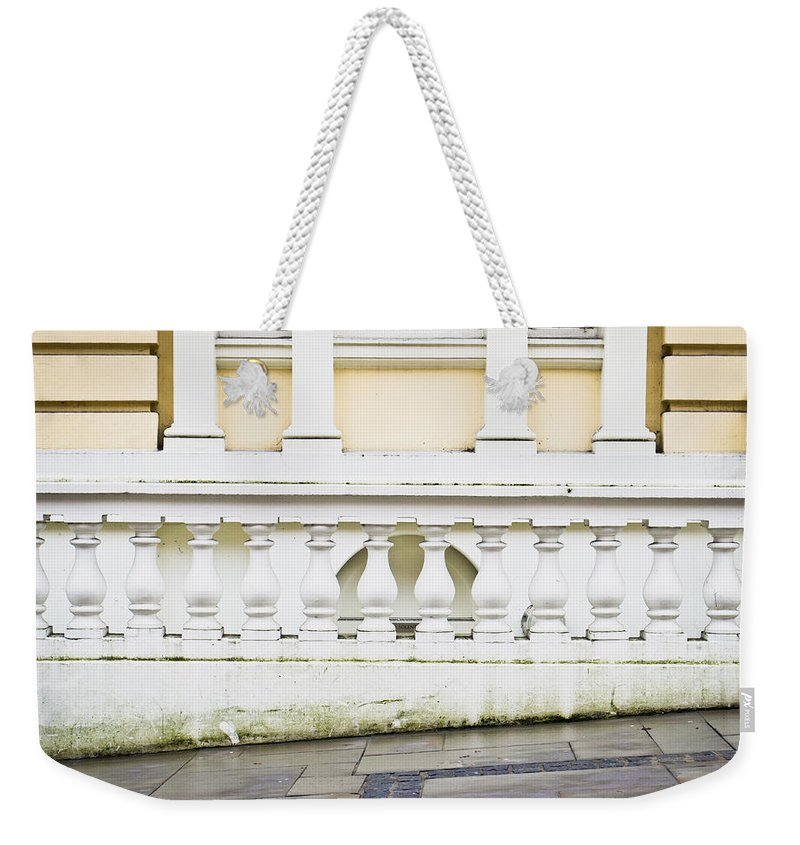 Antique Weekender Tote Bag featuring the photograph Old Architecture by Tom Gowanlock