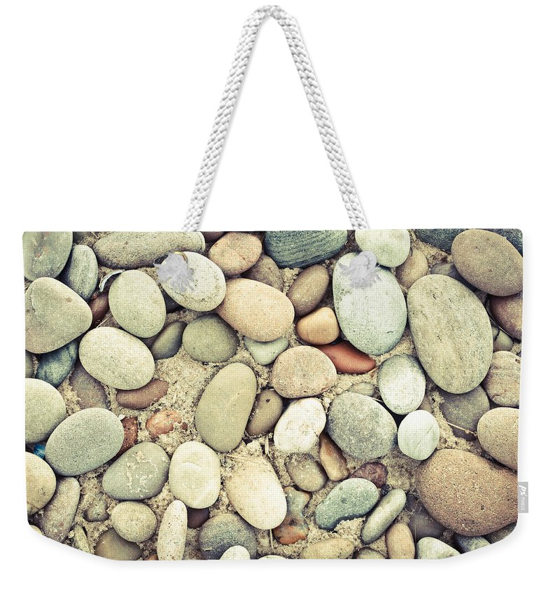 Abstract Weekender Tote Bag featuring the photograph Pebbles by Tom Gowanlock