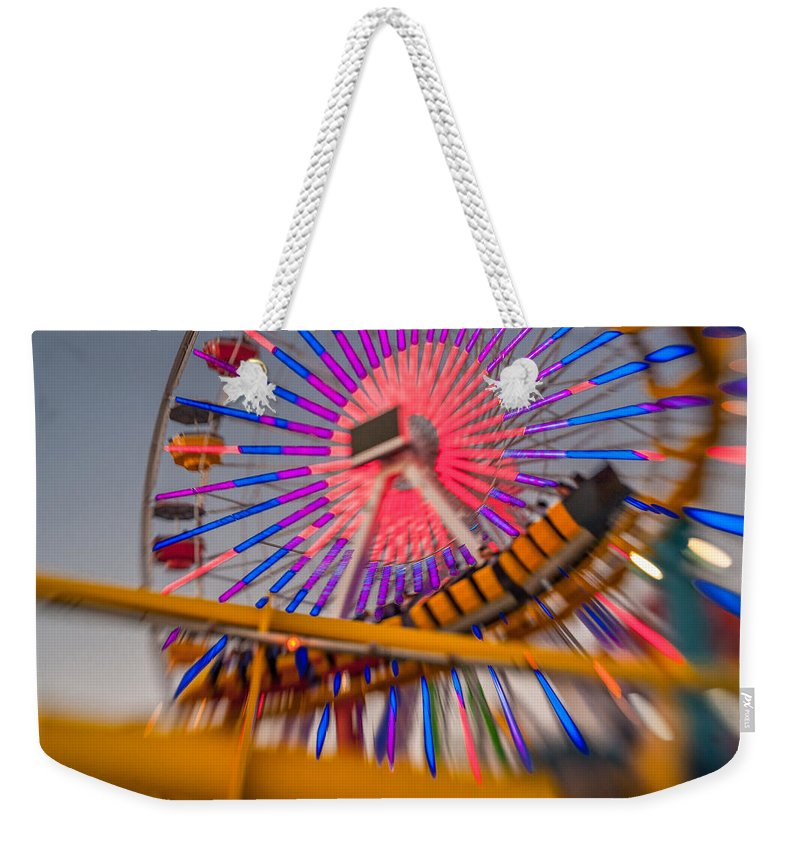 Amusement Park Weekender Tote Bag featuring the photograph Santa Monica Pier Ferris Wheel And Roller Coaster At Dusk by Scott Campbell