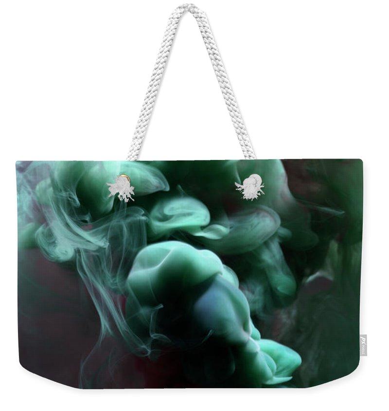 Black Background Weekender Tote Bag featuring the photograph Smoke by Henrik Sorensen