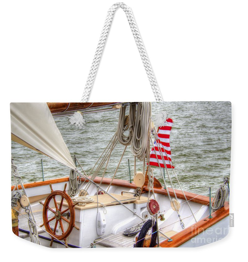 Tall Ships Weekender Tote Bag featuring the photograph At The Helm by Dale Powell