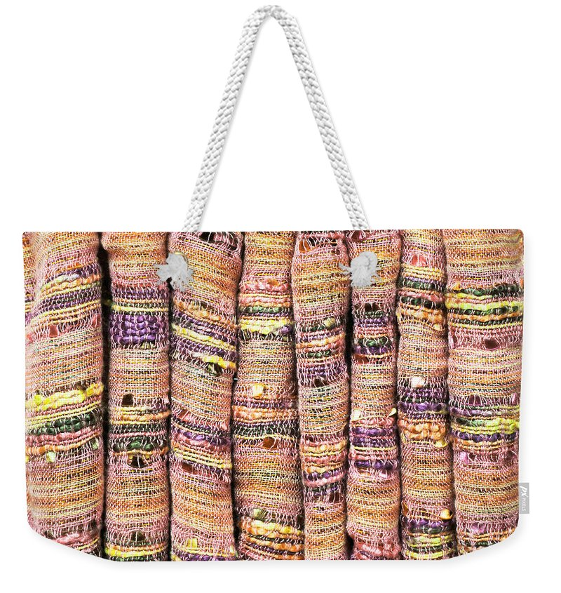 Backdrop Weekender Tote Bag featuring the photograph Textile Background by Tom Gowanlock