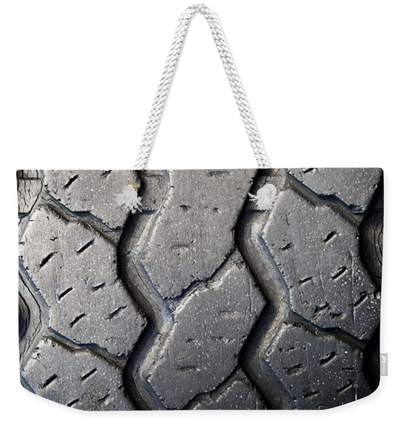 Car Weekender Tote Bag featuring the photograph Tyre Tread by Tim Hester
