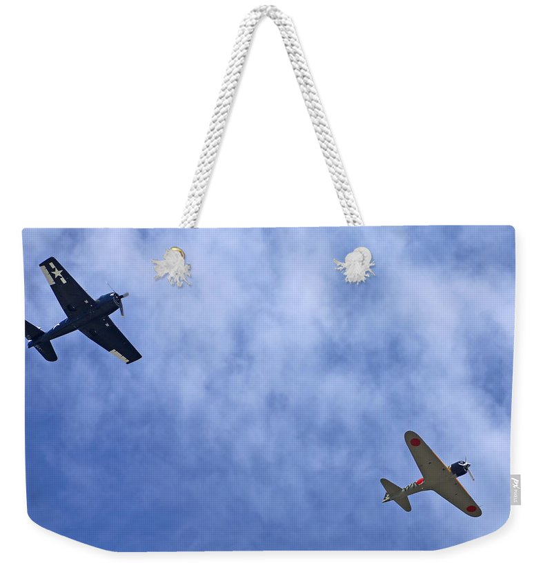 Grumman Weekender Tote Bag featuring the photograph Wwii Planes by Paul Fell