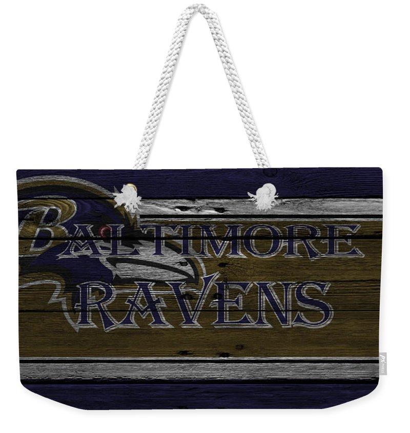 Ravens Weekender Tote Bag featuring the photograph Baltimore Ravens by Joe Hamilton