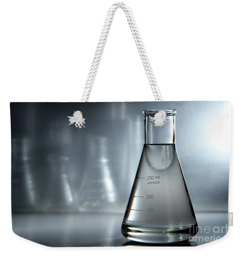 Erlenmeyer Weekender Tote Bag featuring the photograph Laboratory Equipment In Science Research Lab by Science Research Lab By Olivier Le Queinec