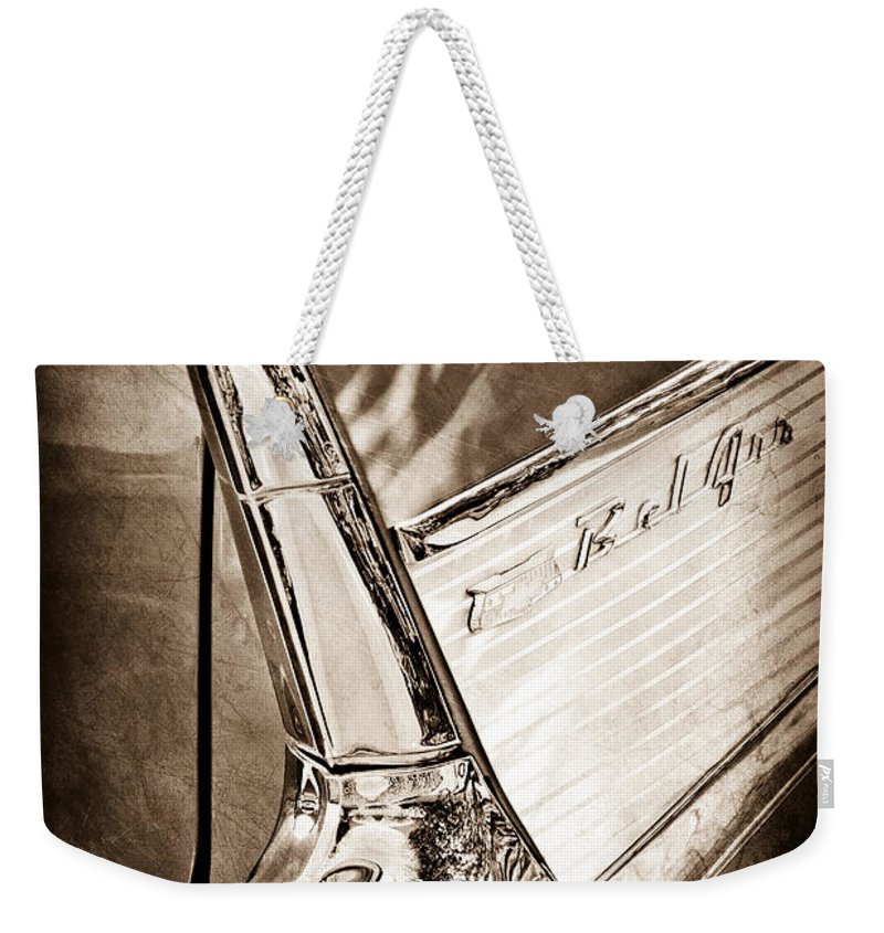 1957 Chevrolet Belair Taillight Emblem Weekender Tote Bag featuring the photograph 1957 Chevrolet Belair Taillight Emblem by Jill Reger