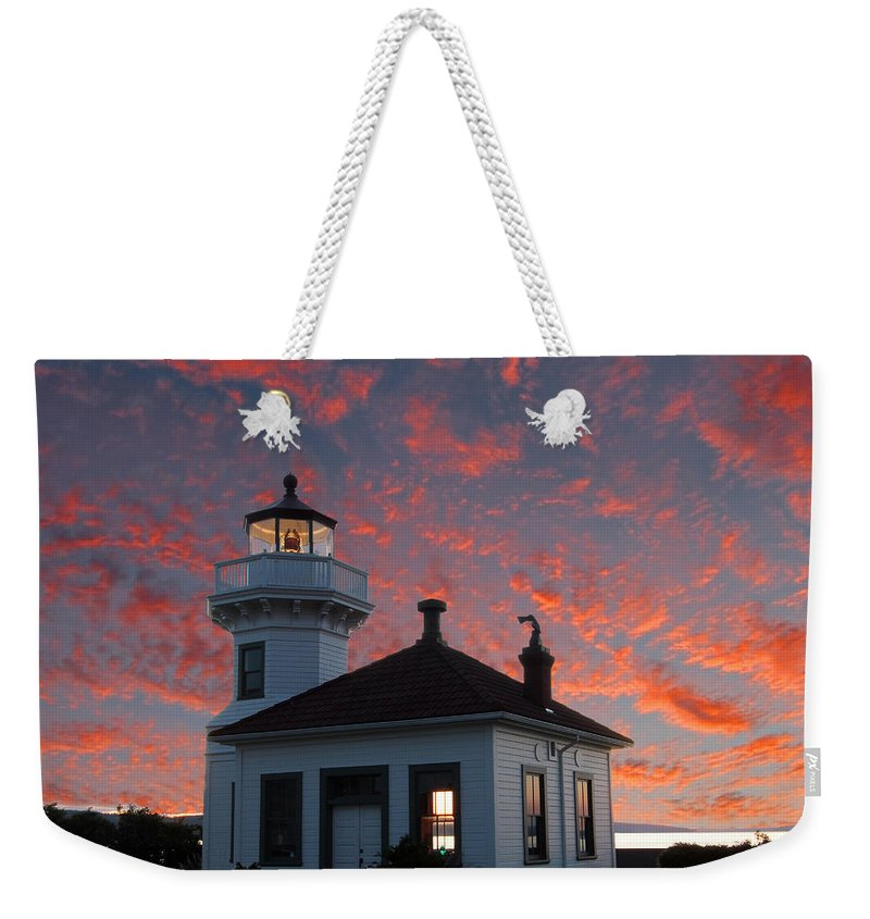 Building Weekender Tote Bag featuring the photograph Lighthouse by Paul Fell