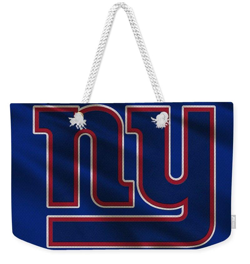 Giants Weekender Tote Bag featuring the photograph New York Giants Uniform by Joe Hamilton