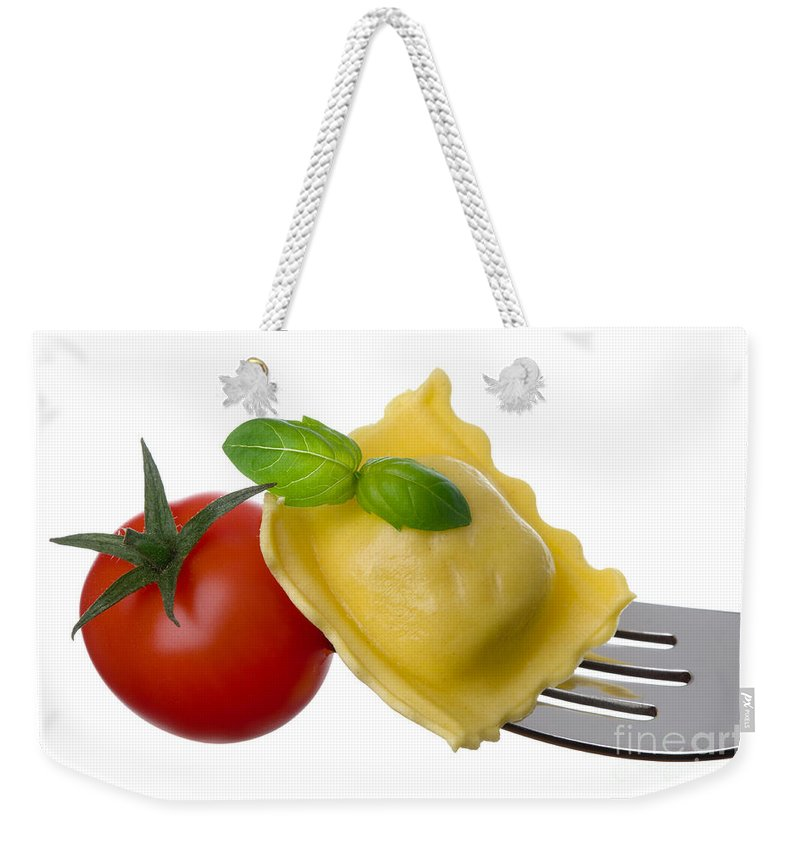 Pasta Weekender Tote Bag featuring the photograph Ravioli Pasta Tomato And Basil On Fork Against White Background by Lee Avison