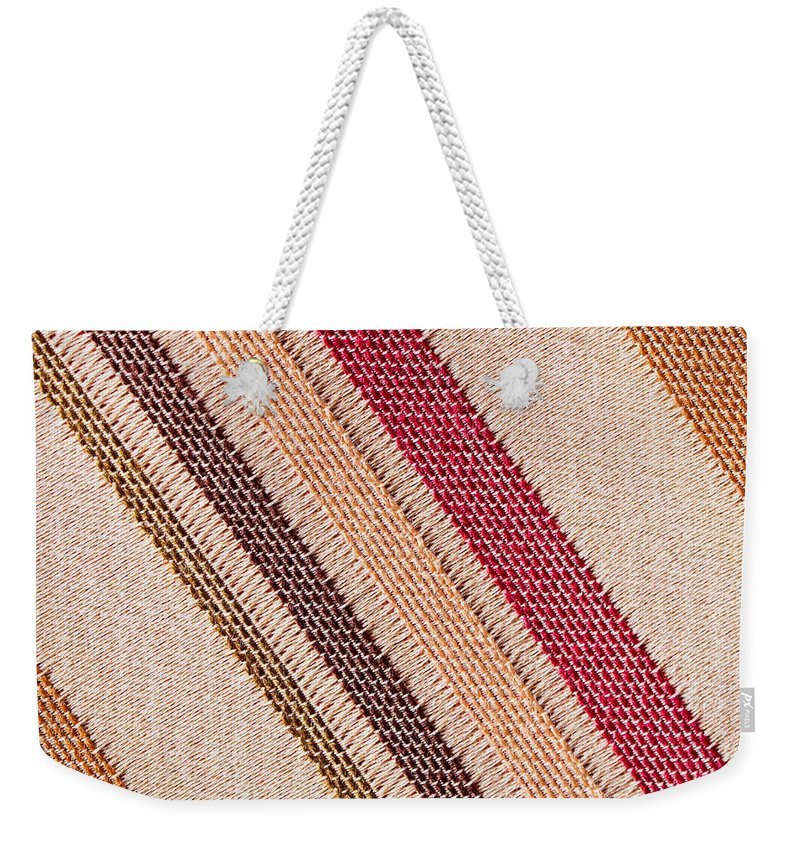 Abstract Weekender Tote Bag featuring the photograph Striped Material by Tom Gowanlock