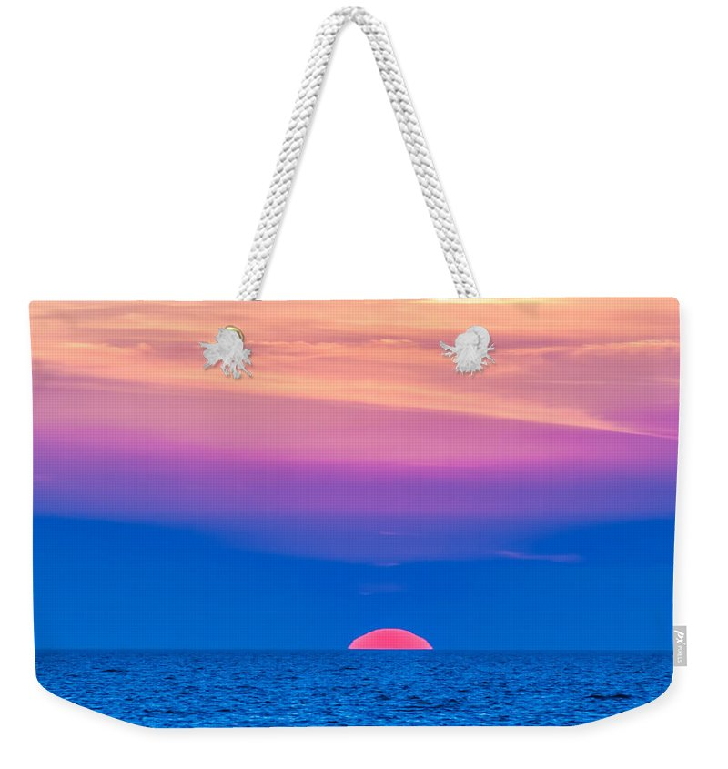 Sunset Weekender Tote Bag featuring the photograph Sunset At Sea With Multiple Color Prizm by Alex Grichenko