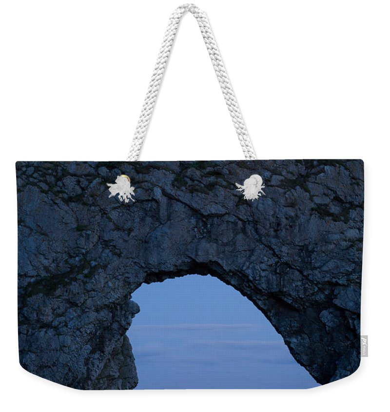 Durdle Weekender Tote Bag featuring the photograph Under The Moonlight by Ian Middleton