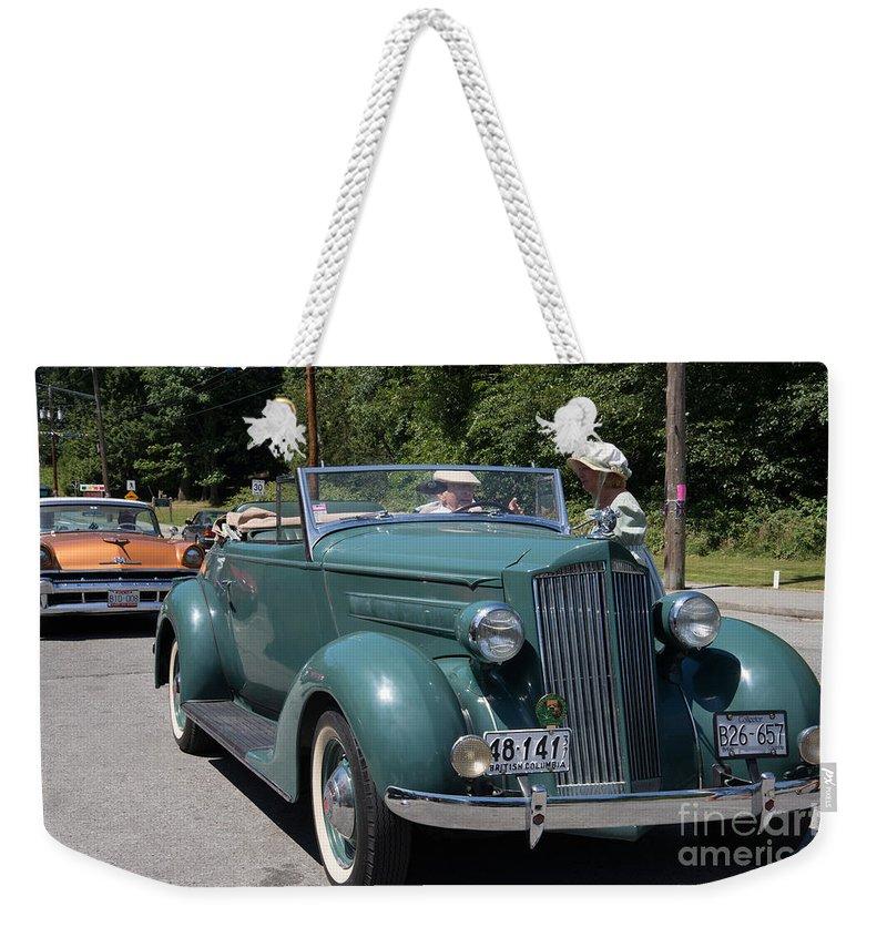 Bowen Island Weekender Tote Bag featuring the digital art Vintage Cars by Carol Ailles