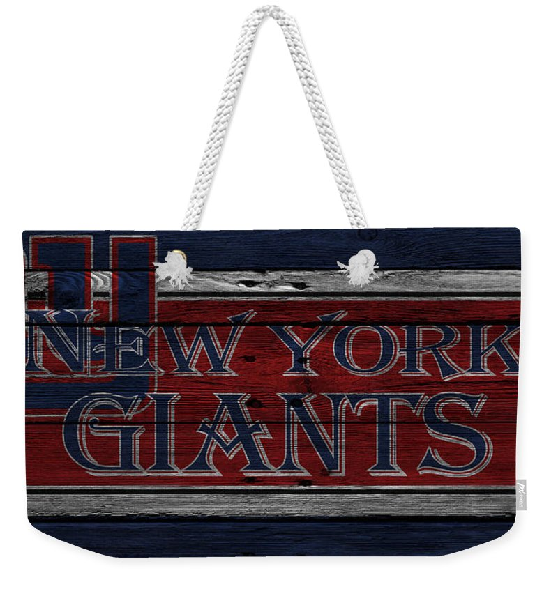 Giants Weekender Tote Bag featuring the photograph New York Giants by Joe Hamilton
